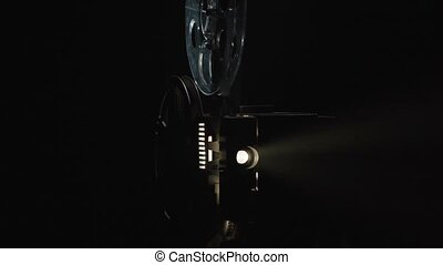Shooting of old projector filming on black background