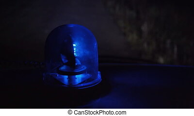 Shooting of rotating blue emergency light in the night