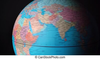 Shooting of spinning around political globe with countries