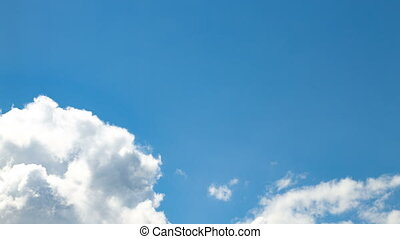 Shooting of the white clouds on blue sky in summer
