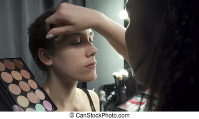 Shooting of visagist applying foundation makeup - Video of ...