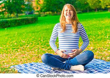 Shooting on the nature of a pregnant girl in autumn