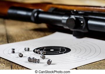 shooting, pneumatic weapon with shield and shotgun at the shooting range