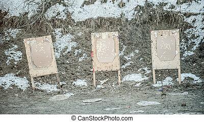 Shooting range target after shooting with shotgun bullet gauge pellets