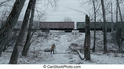Shooting video of passing freight train