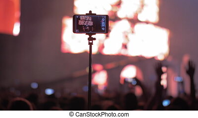 Shooting video with smart phone at the concert