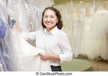 Shop assistant at wedding store