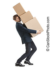 Shop assistant delivers the heavy parcel of three boxes -...