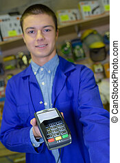 Shop assistant holding card payment device