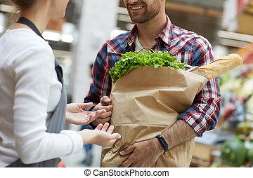 Shop Assistant Talking to Customer Closeup