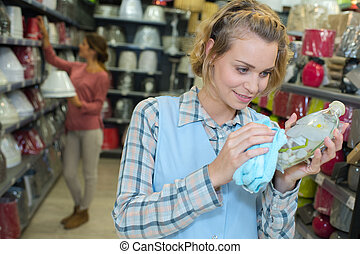 shop assistant with cleaning services