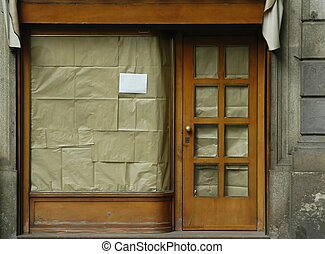 Shop Closed - color - Storefront, view blocked by brown...
