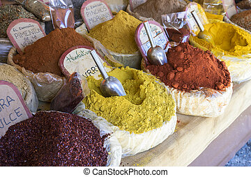 Shop of traditional medicinal herbs, baskets of various spices and condiments for health in a natural way