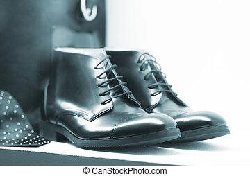 Shop window fashion store mens shoes