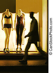 Shop Window - Man walking across a shop window