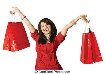 Shopaholic - A beautiful young female holding shopping bags...
