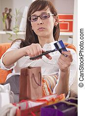 shopaholic cutting credit card - shopaholic woman with...