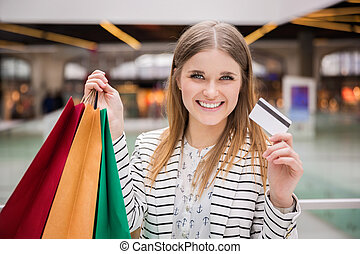 Shopaholic girl - A photo of young, happy woman with...