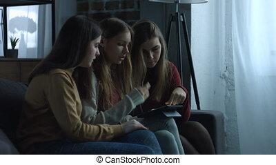 Shopaholic girls shopping online with digital tablet - Three...