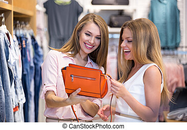 Shopaholic - Young smiling woman in a store