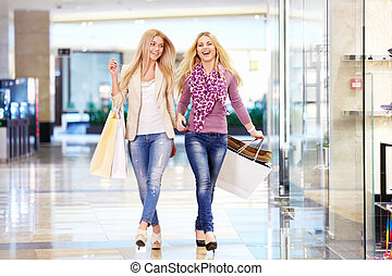 Shopaholic - Young attractive girls in the shop