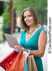 shopaholic, vrouw, met, tablet pc
