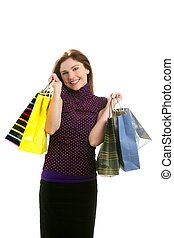 Shopaholic woman with colorful bags over white