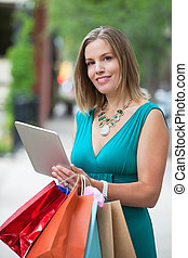 Shopaholic Woman With Tablet PC