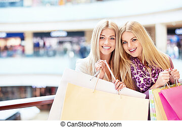 Shopaholic - Young women with shopping bags