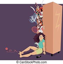 Shopaholic's problem - Overfilled closet bursting with...