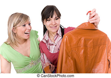 shopaholics - two attractive women with clothes.