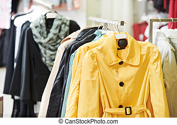 clothes on hanger in shop - shoping sale background theme. ...