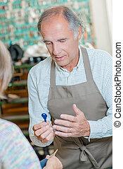 Shopkeeper selling a duplicate key