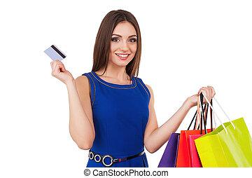 shoppen , woman., lachen, jonge dame, vasthouden, kredietkaart, en, het winkelen zakken