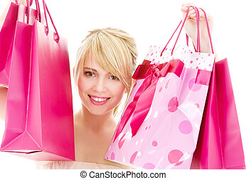 shopper - happy teenage girl with pink shopping bags