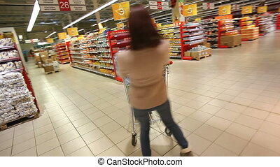 Shopper having fun - Female shopper having fun in mall...
