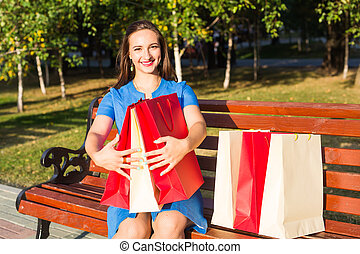 Shopper. Shopaholic shopping woman holding many shopping bags excited. Addiction concept
