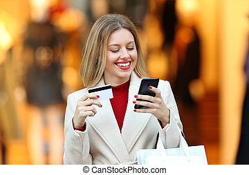 Shopper shopping paying with credit card online
