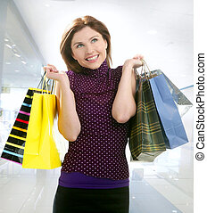 Shopper woman shopping on the city - Shopper smiling woman...