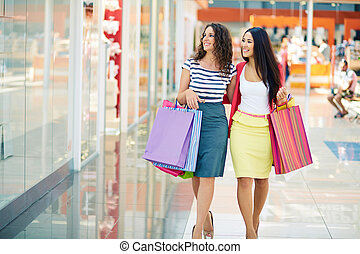 Shoppers in the mall - Gorgeous girlfriends with paper bags...