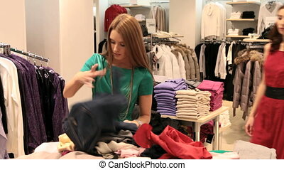Shoppers quarreling - Girls fighting over a piece of clothes...