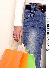 Shopping - A woman carrying a shopping bag