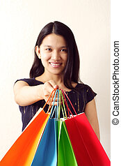 Shopping - A woman with shopping bags