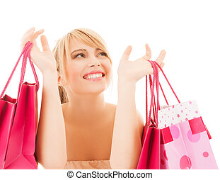 happy woman with many shopping bags - shopping and sales...