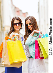 girls with shopping bags in ctiy - shopping and tourism ...
