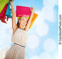 woman with shopping bags - shopping and tourism concept - ...