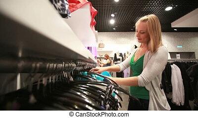 Shopping as a hobby - Beautiful blonde girl enjoying her...