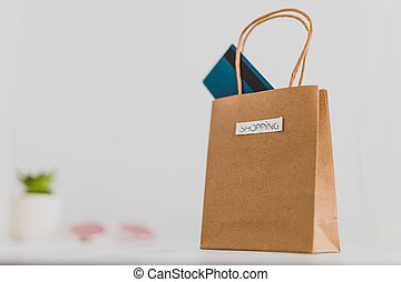 shopping bag on marble table top with mix of daily and ...