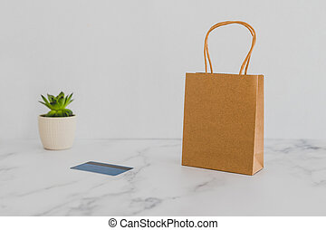 shopping bag on marble table top with payment card, shot at ...