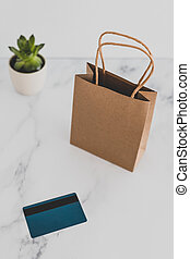 shopping bag on marble table top with payment card